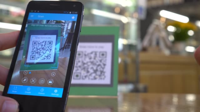 qr code cashless payment. scan to pay system. business or technology concept - kodować filmów i materiałów b-roll