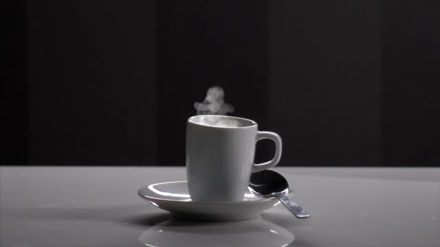 Coffee beans and a cup of steaming coffee video