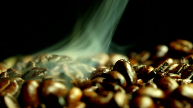 Coffee beans and steam Coffee beans and steam roasted stock videos & royalty-free footage