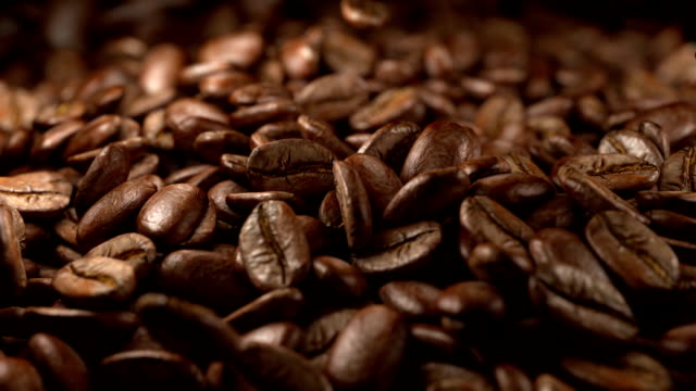 Coffee beans falling High quality super slow motion coffee beans falling.  roasted stock videos & royalty-free footage