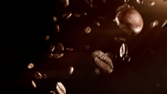 hd: kaffeebohnen flug - rohe kaffeebohne stock-videos und b-roll-filmmaterial