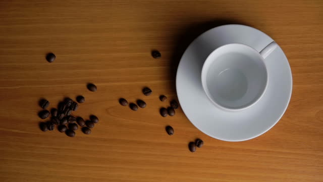 Coffee beans in a cup and crawl welded video