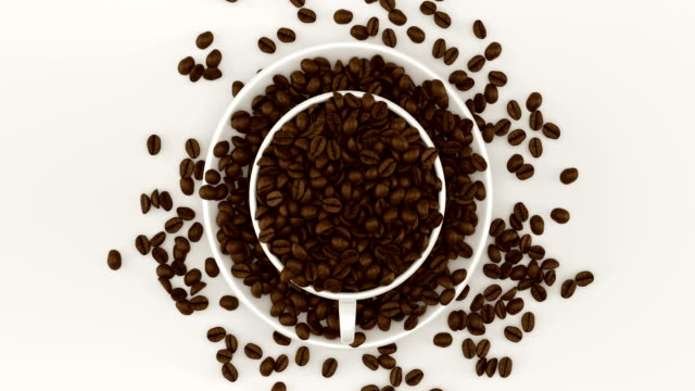 Coffee beans in a cup rotating video