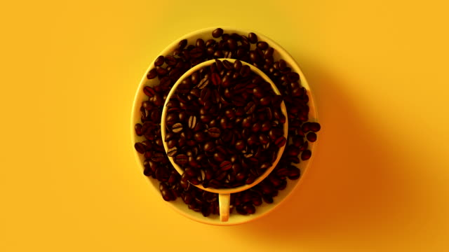 Coffee beans in a yellow cup rotating. video