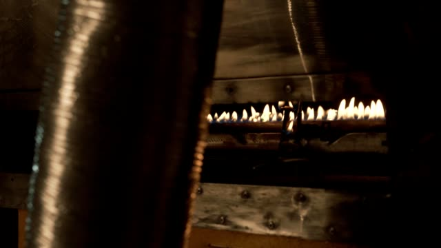 Coffee beans in roaster on burning fire in motion video