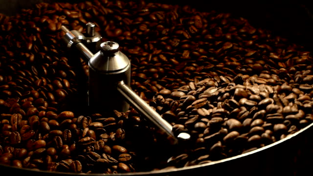 coffee beans in the grinder. fresh coffee in coffee professional machine. aroma, background. - coffee стоковые видео и кадры b-roll