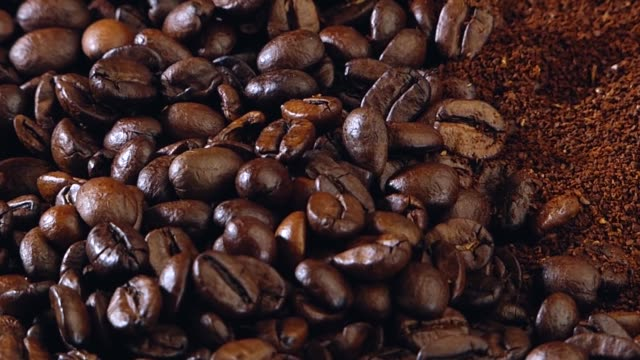 coffee beans Roasted coffee beans grind stock videos & royalty-free footage