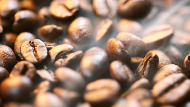coffee beans with smoke coffee beans fresh roast with smoke, Sliding shot. roasted stock videos & royalty-free footage