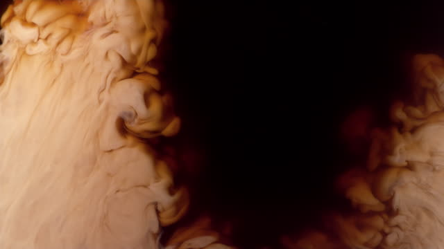 coffee creamer swirling in coffee, slow motion - coffee stock videos & royalty-free footage