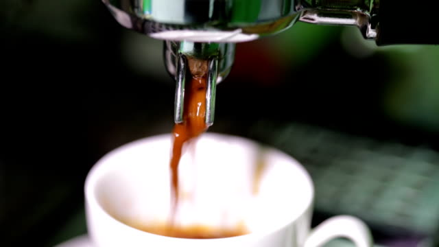 Coffee cup filled to the brim. Coffee maker fills cup of coffee video