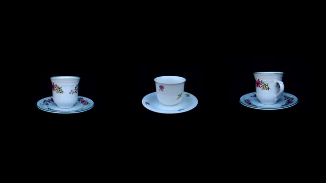 coffee cup rotation on isolated black video