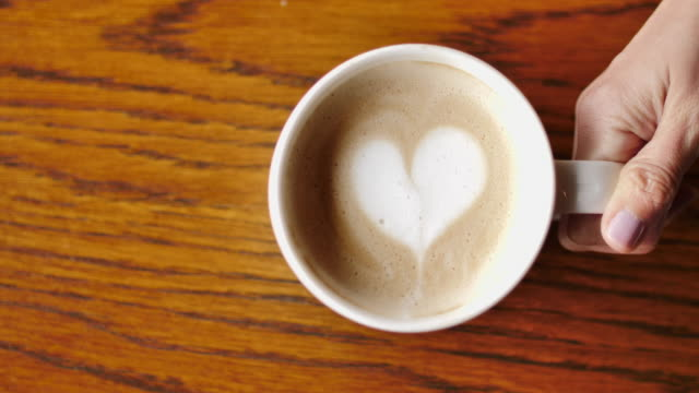 Coffee cup with Latte art heart video