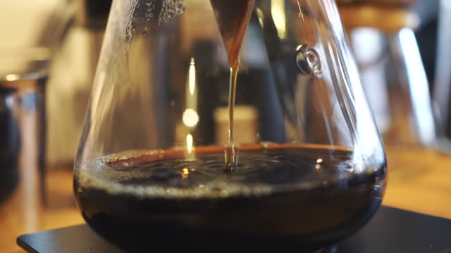 Coffee Flows Into The Pot. Coffee Drips. v60 Coffee Brew