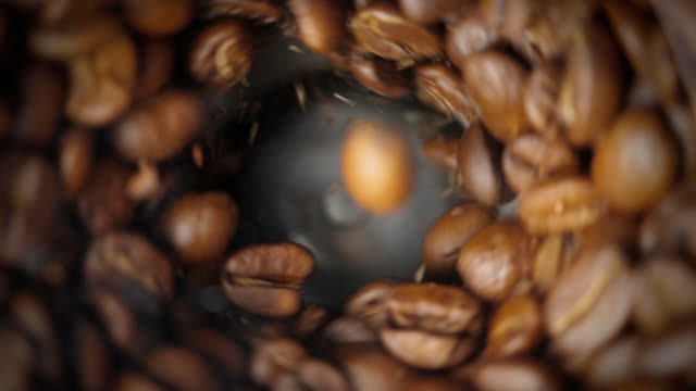 Coffee grinder. Close-up shot. Electric coffee grinder works. Slow motion. High angle view. coffee stock videos & royalty-free footage