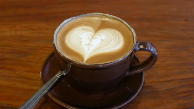 Coffee latte art at coffee shop , 4k resolution , UHD video