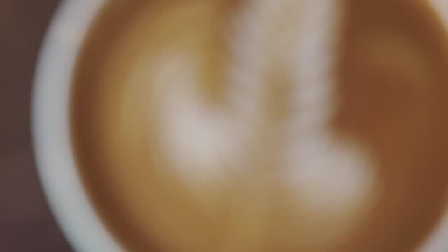 coffee latte art pattern rosetta shape, top view.