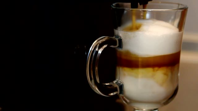 Coffee machine making latte video