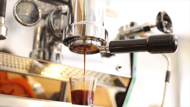 Coffee machine pouring into cup video