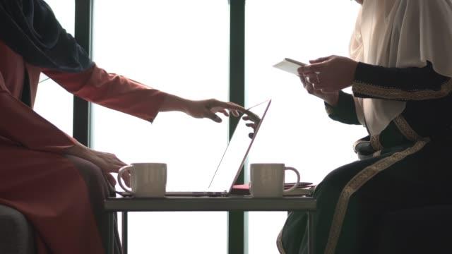 Coffee meeting and working muslim theme
