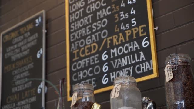 Coffee menu in cafe Coffee menu in cafe menu stock videos & royalty-free footage