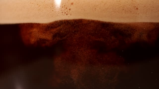 Coffee mixing with milk. Super Slow motion.