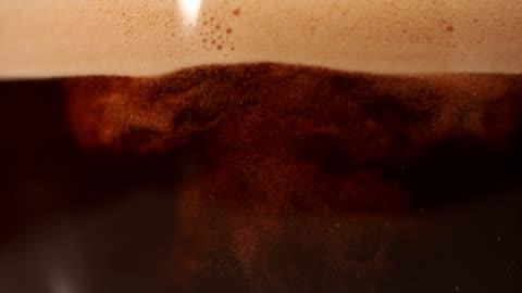 vídeos de stock e filmes b-roll de coffee mixing with milk. super slow motion. - castanho