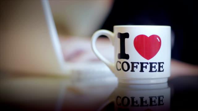 Coffee mug on the glass table video