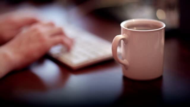 Coffee mug on the wooden desk video