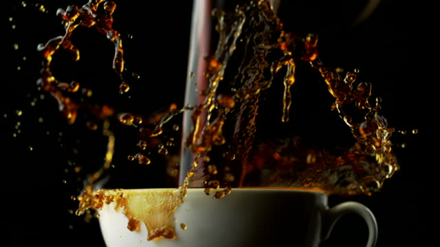 Coffee over-spilled in cup, Slow Motion video
