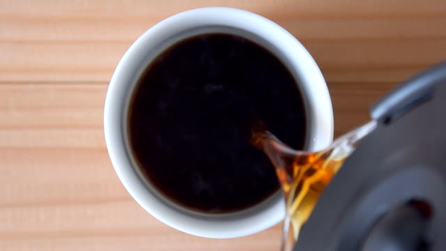 coffee pouring into a cup coffee pouring into a cup - close up view coffee stock videos & royalty-free footage