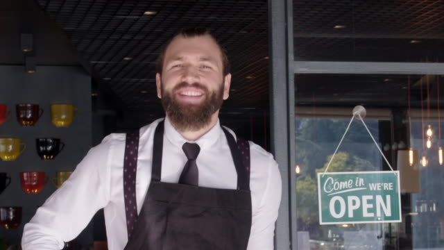 coffee shop owner posing - open sign stock videos & royalty-free footage