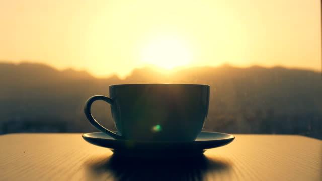stockvideo's en b-roll-footage met koffie tijd, koffie kopje op tafel - photography curtains