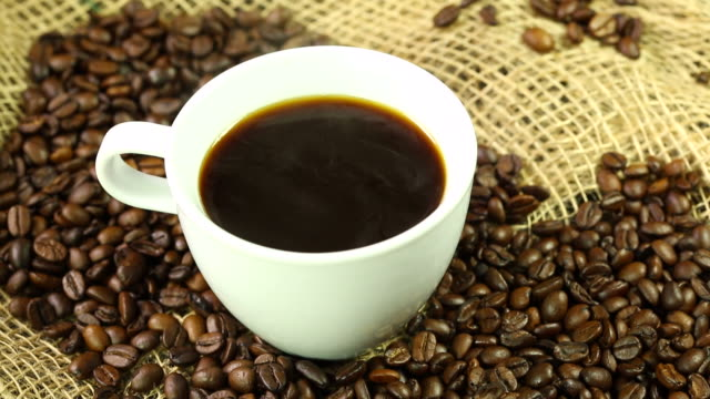 Coffee with beans Coffee with beans. Moving camera kaffee stock videos & royalty-free footage