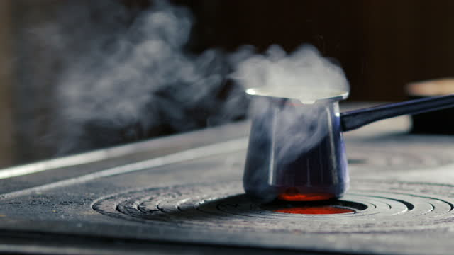 Coffeepot With Boiling Water on Wood Burning Stove