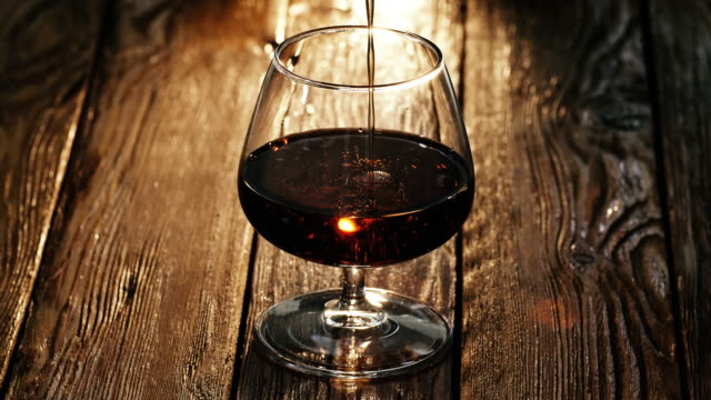 cognac being poured into the glass - brandy video stock e b–roll