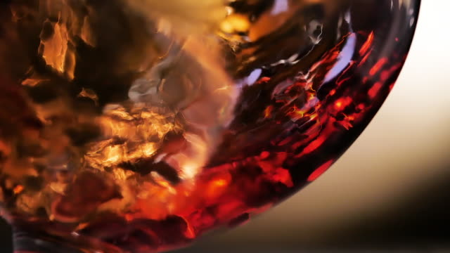 Cognac is rotated in a glass. On dark background. Cognac is rotated in a glass. On dark background. Slow Motion. tasting stock videos & royalty-free footage