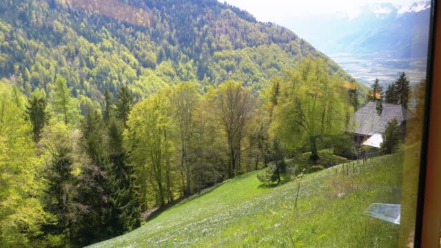 Cogwheel Train in Mountains. Train in Steep Mountains Driving Uphill. Switzerland, Montreux, Rochers-de-Naye