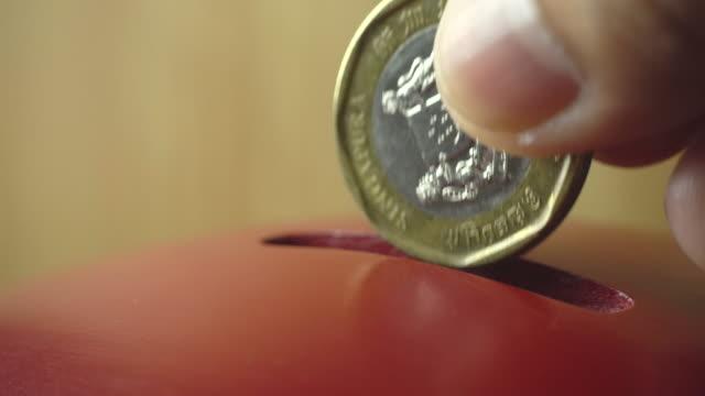 vídeos de stock e filmes b-roll de coin being inserted into a vintage donation box, 4k - benefits