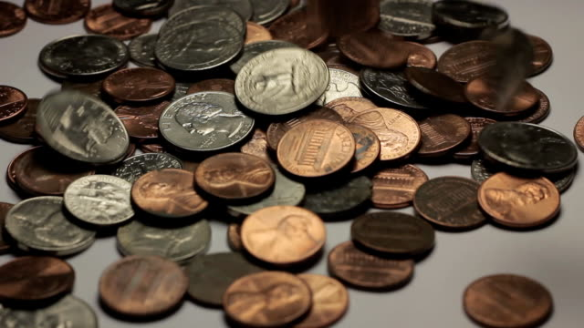 US Coin Drop American coins being dropped onto a white table. us coin stock videos & royalty-free footage