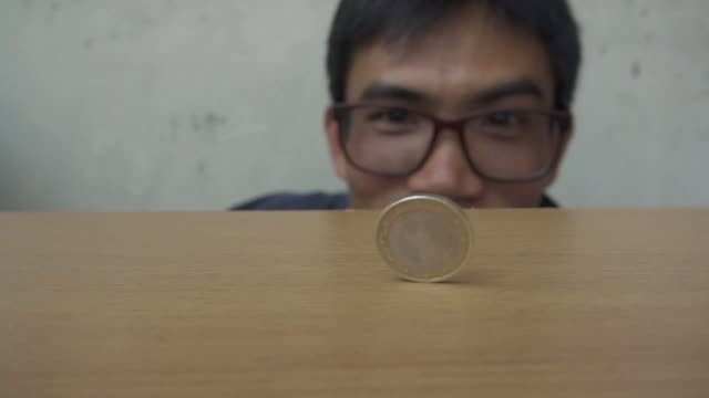 coin spinning slow motion video