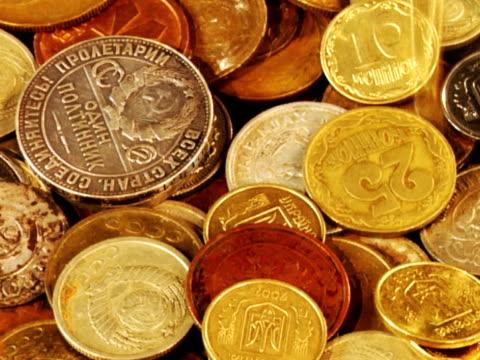 coins fall dawn slow motion video