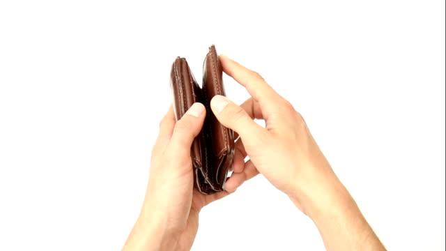 coins falling into open wallet - 銀包 個影片檔及 b 捲影像