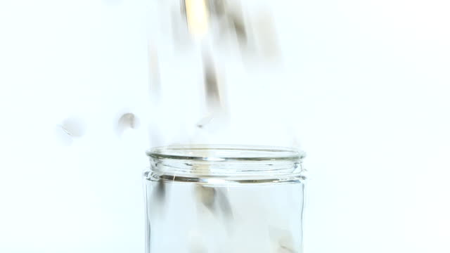 Coins Filling into glass jar video