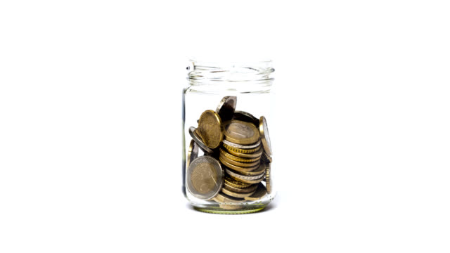 Coins in a jar. Coins in a jar. european union currency stock videos & royalty-free footage