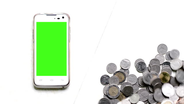 Coins increase and green screen of smart phone.