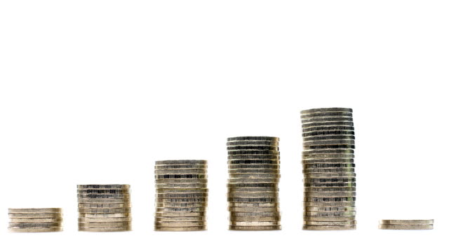 Coins on stack on white background - stop motion