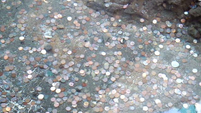 Coins on the bottom of a wishing well fountain in slow motion Professional video of coins on the bottom of a wishing well fountain in slow motion 180fps copper stock videos & royalty-free footage