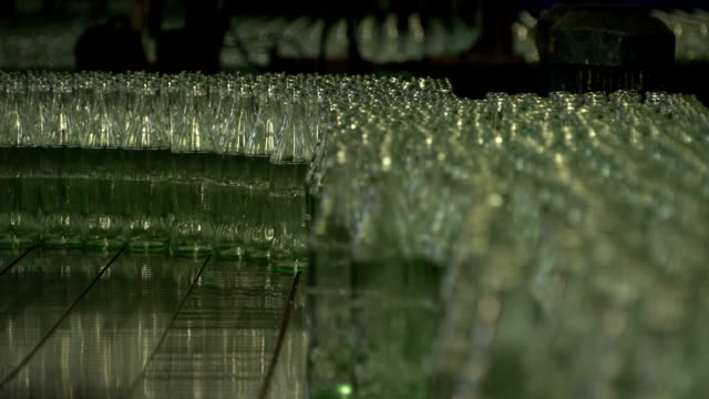 Cola bottle glass manufacturing industrial factory.  Empty Transparent Bottles Moving on Conveyor Belt. Technological line production Glass factory. cola stock videos & royalty-free footage