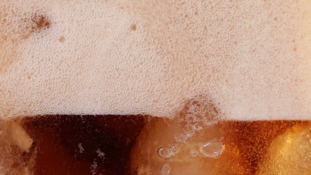 Cola flat glass pour and fill Specially shot from behind flat glass, to provide a wide background with even focus, and space for copy, here a cola drink slowly fills the frame amongst ice, fizziness and bubbles. soda stock videos & royalty-free footage