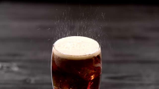Cola pouring into glass with ice cubes. Close up Cola pouring into glass with ice cubes standing on a dark table. Close up cola stock videos & royalty-free footage
